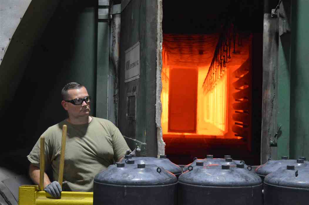 man-with-safety-glasses-standing-in-front-of-industrial-oven