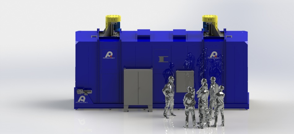 Conveyorized indexing oven built by PQ Ovens for an electric car manufacturer with oven workers standing in front of it.